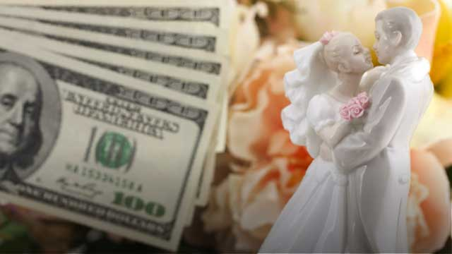 Money and a cake topper